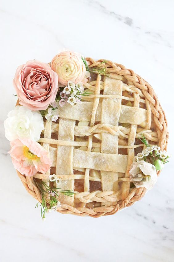 a covered apple pie topped with blooms is great instead of a cake for a fall bridal shower