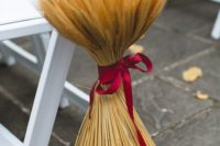 19 a fall wedding aisle marker of wheat with a plum-colored ribbon is ideal for a rustic wedding