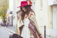 19 a folk boho bridal look with a lace dress, a folksy coverup and a raspberry-colored hat