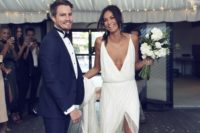 19 a fresh take on a classic slip with a fully embellished slip wedding dress with a plunging neckline and a high front slit