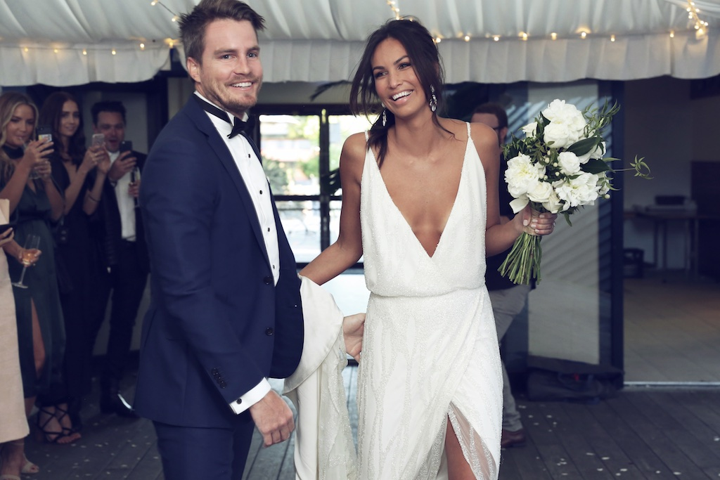 a fresh take on a classic slip with a fully embellished slip wedding dress with a plunging neckline and a high front slit