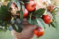 20 a catchy fall wedding centerpiece of blush blooms, leaves, cabbage and pomegranates in an urn