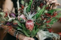 20 a colorful wedding bouquet with proteas, herbs and greenery plus balck ribbons