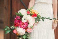 20 a gorgeous all-sparkling slip wedding dress with a V-neckline and a bright wedding bouquet