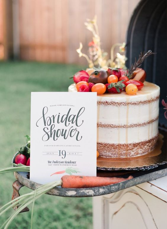 a naked cake topped with fruits and vegetables is right what you need for a rustic bridal shower