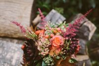 20 a woodland fall wedding bouquet with blooms, herbs and brown fall leaves