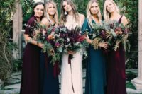 20 mismatched plum-colored and teal dresses of different designs look very spectacular and bold