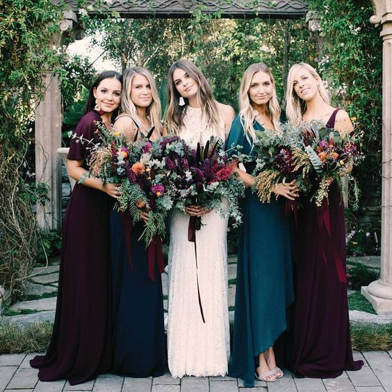 mismatched plum-colored and teal dresses of different designs look very spectacular and bold