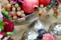 21 a chic fall centerpiece with grapes, pomegranates and dark dahlias in a silver bowl