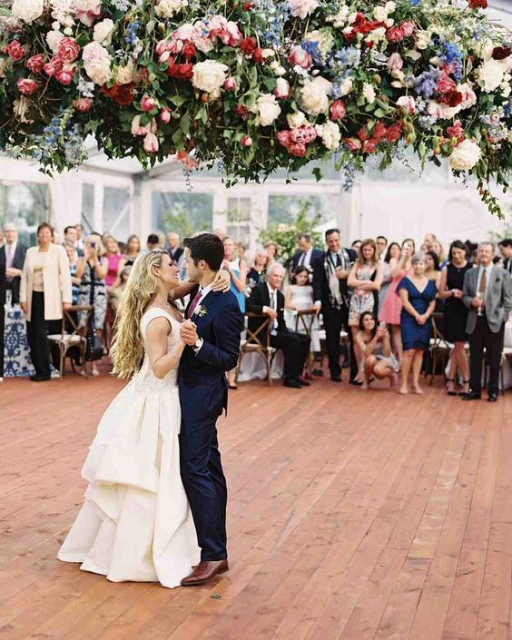 a gorgeous romantic floral suspended decoration in pink, blue and white plus greenery is a fantastic idea for a dance floor