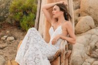 a lace slip gown with a deep V-neckline and an open back for a romantic feel