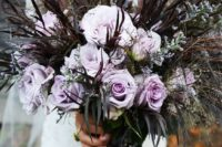 21 a lavender rose wedding bouquet with dark grasses for a haunted wedding