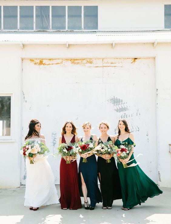 all different bridesmaids' dresses in teal,emerald, red and black with different designs