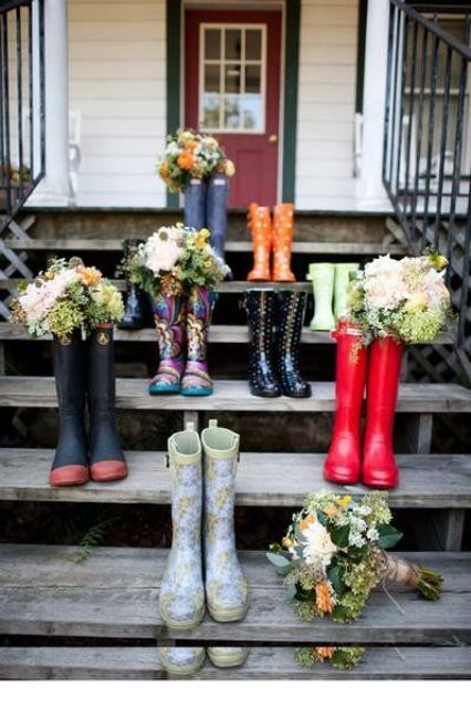 differently looking rubber boots for each bridesmaid and their bouquets inside