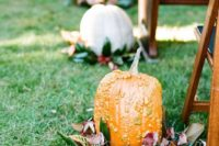 21 fall pumpkins placed on magnolia leaves are a great idea for a fall wedding, especially a southern one