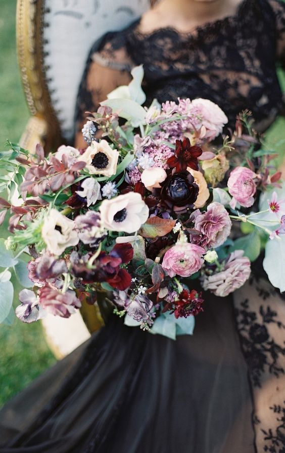 a luxurious bouquet with pink, burgundy and white blooms and greenery and foliage