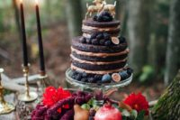 22 a naked chocolate fall wedding cake topped with blackberries, figs and gold deer for a woodland location