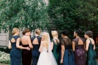 22 mismatching jewel tone bridesmaids' dresses in green, navy, burgundy and purple with embeliishments