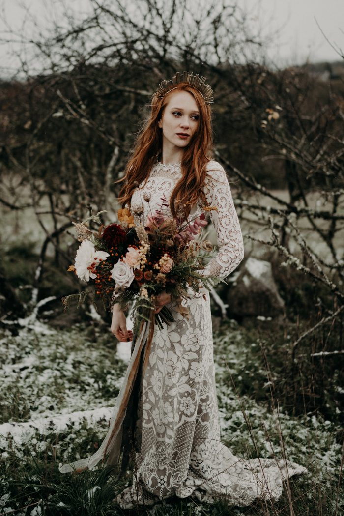 a moody fall bride with long red hair down and a creative metallic crown for a more eye-catchy look