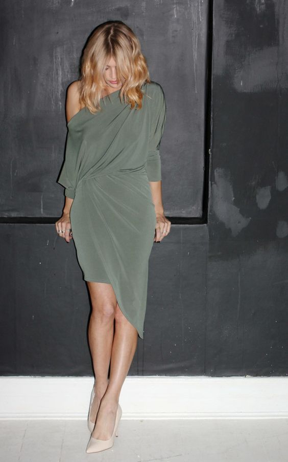 a one shoulder olive green draped dress with long sleeves and nude shoes