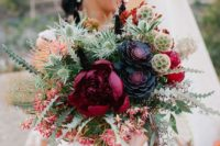 23 a super bold bouquet with burgundy, black and hot red blooms plus a lot of textural greenery