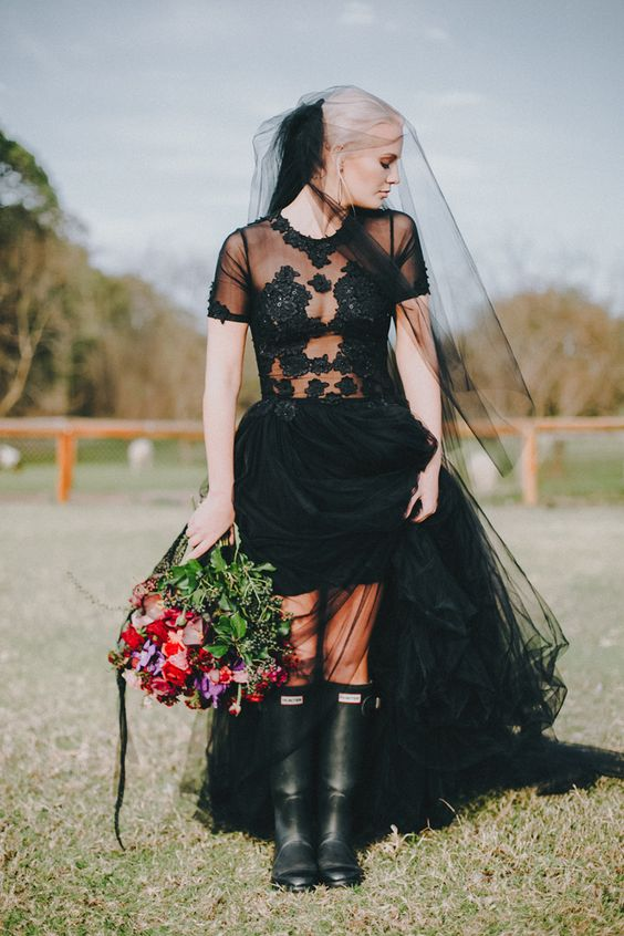 black rubber boots as a statement for an outdoor ceremony somewhere in a forest