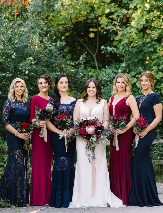 navy and fuchsia maxi dresses with lace inserts highlight the white dress of the bride very well