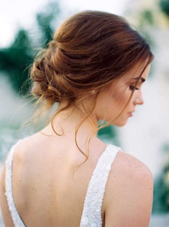 a messy wavy low bun with some locks down is sure to keep looking cool after the rain