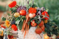 24 a rustic fall wedding centerpiece with apples, radish and carrots plus lavender and some blooms