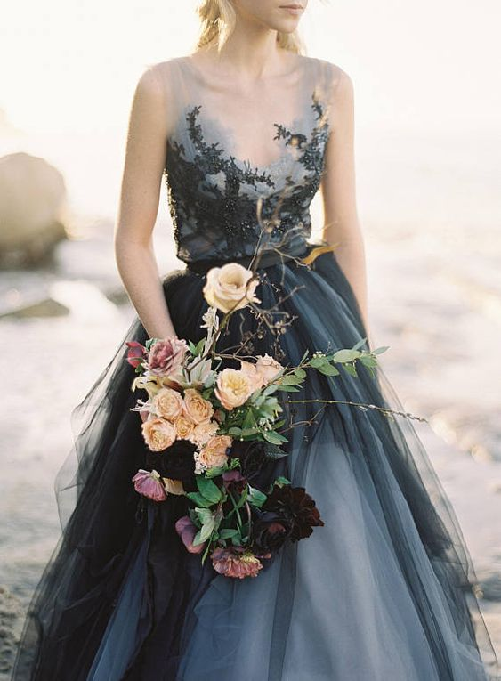 a wedding dress with a grey and black lace bodice and a layered grey and black skirt