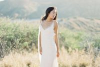 24 an all-lace slip wedding gown plus waves down is a very cute and romantic idea