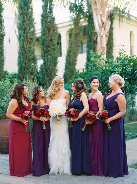 navy, purple, fuchsia and red maxi dresses with mismatched necklines but in the same style