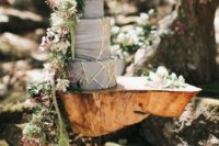 25 a stunning grey marble wedding cake with gold geometric decor and lush cascading blooms and greneery