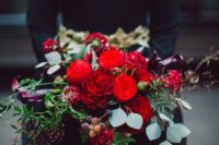 25 a super colorful Halloween wedding bouquet with red and dark purple blooms plus berries and greenery