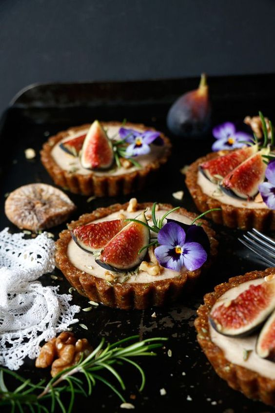 grain-free vegan tarts with a blend of spices and edible flowers on top