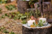 25 tree stumps with fall leaves and large candle holders are ideal for rustic or woodland weddings