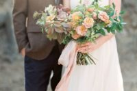 26 a delicate wedding bouquet with blush and lilac blooms plus foliage of various shades and pink ribbons