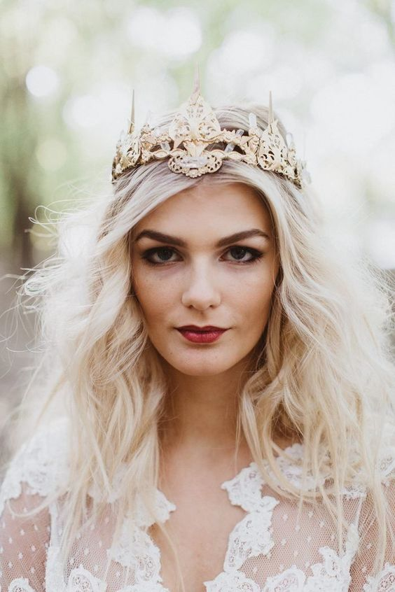 an eye-catchy gold bridal tiara is a great idea to pull off a queen-like look