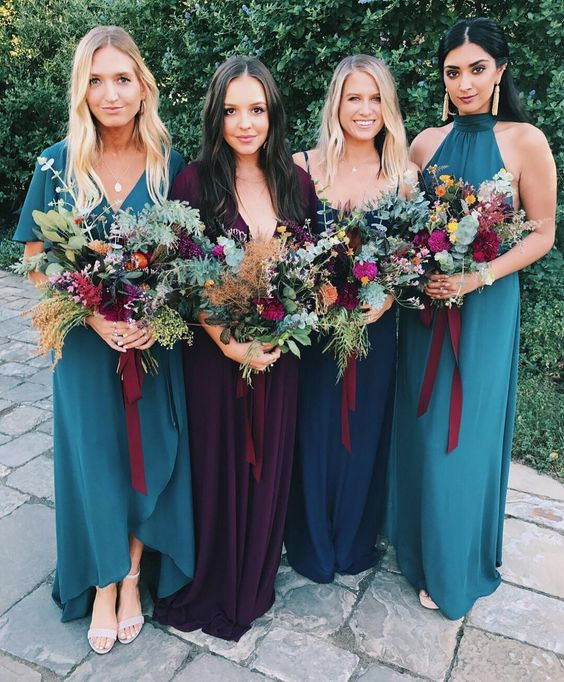 teal, navy and purple mismatching maxi dresses with different designs - mismatch done right