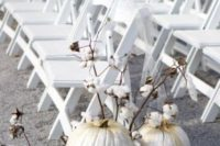 26 white pumpkins gilded on the top and cotton branches can be nice wedding aisle markers for a southern wedding