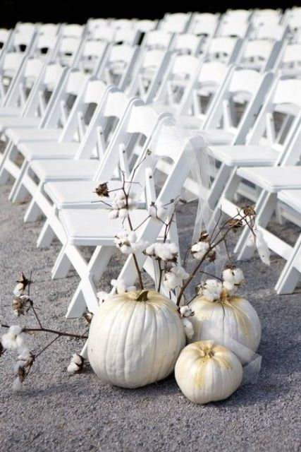 white pumpkins gilded on the top and cotton branches can be nice wedding aisle markers for a southern wedding