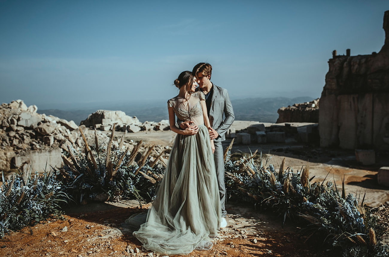 This gorgeous grey and blue elopement took place in an abandoned marble quarry in Spain