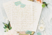 02 Here are wedding vows, chic gold calligraphy served on a tray with blooms