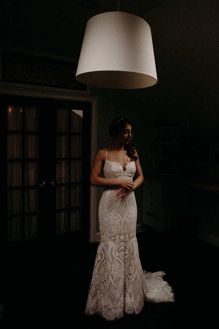 The bride was wearing a beautiful lace mermaid wedding gown with spaghetti straps, a train and a touch of sparkle