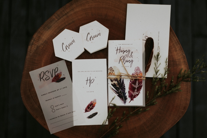 The wedding invitation suite showed off the boho feel of the wedding with painted feathers