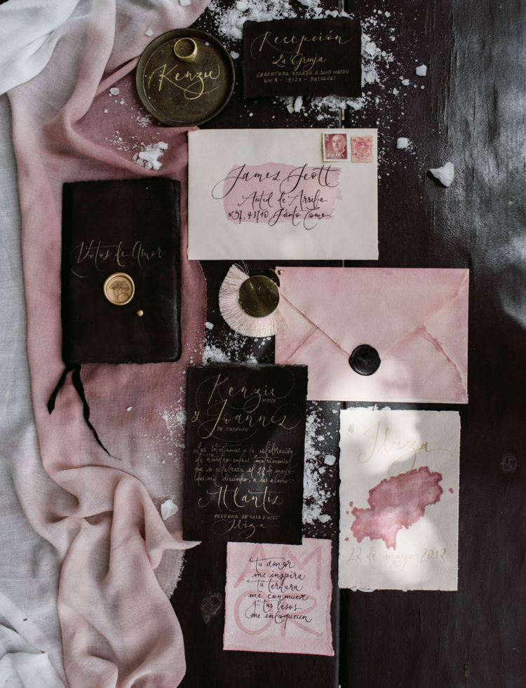 The wedding invitation suite was done in black and pink as the bride's hair is pink