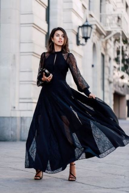 a beautiful maxi black dress with a partly sheer skirt and a cutout on the neckline