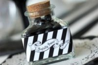 02 a bottle filled with black candies and with a proper label can be easily DIYed