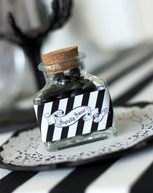 a bottle filled with black candies and with a proper label can be easily DIYed
