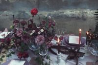 02 a dark floral centerpiece in the shades of purple, dusty pink and burgundy plus dark greenery